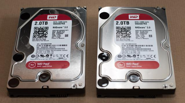 Two red WD hard disk drives.